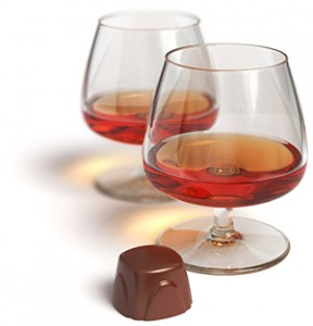 Two inviting glasses and chocolate